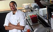 Devon Miller works in the kitchen at 3 Penny Restaurant located in Charlottesville, Va. Photo/Andrew Shurtleff