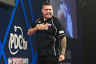 Michael Smith celebrates winning the fourth set in his match against Mervyn King during the William Hill World Darts Championship at Alexandra Palace, London, United Kingdom on 23 December 2016. Photo by Shane Healey.
