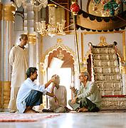 Men congregating in the Bara Imambara, a grand shrine for Shia Muslims. Lucknow, Uttar Pradesh, India