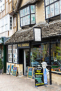 Traditional quaint English butcher, W.J. Castle in Burford High Street in The Cotswolds, Oxfordshire, UK