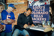 SHOT 12/10/17 12:38:39 PM - Former Buffalo Bills wide receiver and Hall of Fame player Andre Reed signs autographs and meets with fans at LoDo's Bar and Grill in Denver, Co. as the Buffalo Bills played the Indianapolis Colts that Sunday. Reed played wide receiver in the National Football League for 16 seasons, 15 with the Buffalo Bills and one with the Washington Redskins. (Photo by Marc Piscotty / © 2017)