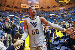 Dec 1, 2018; Morgantown, WV, USA; West Virginia Mountaineers forward Sagaba Konate (50) celebrates with fans after beating the Youngstown State Penguins at WVU Coliseum. Mandatory Credit: Ben Queen-USA TODAY Sports