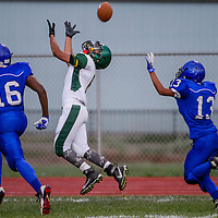 Thoreau Hawk Sean Emerson (6)  gets clear of the Laguna Acoma Hawks as he tries for a long pass Friday at Grants High School.
