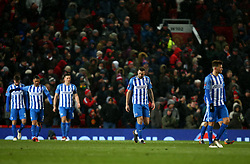 Brighton and Hove Albion players look dejected after going two goals down