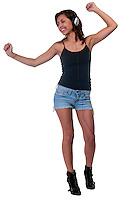 Portrait of hispanic girl listening music with headphones and dancing very happy.