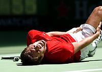 MELBOURNE, AUSTRALIA - JANUARY 19:  John Van Lottum of Holland collapses to the floor with cramp during his match against Gustavo Kuerten of Brazil during day one of the Australian Open January 19, 2004 in Melbourne, Australia. (Photo by Lars Mueller/Sportsbeat) *** Local Caption ***  John Van Lottum