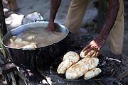 Macapa_AP, Brasil...Comunidade remascente de quilombolas do Curiau, em Macapa, Amapa. Na foto producao de farinha...The Quilombola remaining of Curiau, in Macapa, Amapa. In this photo a man is doing farinha (typical Brazilian food)..Foto: JOAO MARCOS ROSA / NITRO