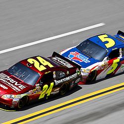 April 17, 2011; Talladega, AL, USA; NASCAR Sprint Cup Series driver Mark Martin (5) drafts Jeff Gordon (24) during the Aarons 499 at Talladega Superspeedway.   Mandatory Credit: Derick E. Hingle