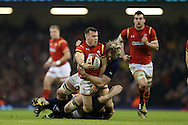 Gareth Davies of Wales © is tackled . RBS Six nations championship 2016, Wales v Scotland at the Principality Stadium in Cardiff, South Wales on Saturday 13th February 2016. <br /> pic by  Andrew Orchard, Andrew Orchard sports photography.