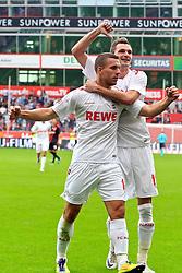 17.09.2011,  BayArena, Leverkusen, GER, 1.FBL, Bayer 04 Leverkusen vs 1. FC Koeln, im Bild.Torjubel / Jubel  nach dem 0:1 durch Milivoje Novakovic (Koeln #11). Doch der Torschütze zeigt auf den Vorbereitet Lukas Podolski (Koeln #10)..// during the 1.FBL, Bayer Leverkusen vs 1. FC Köln on 2011/09/17, BayArena, Leverkusen, Germany. EXPA Pictures © 2011, PhotoCredit: EXPA/ nph/  Mueller *** Local Caption ***       ****** out of GER / CRO  / BEL ******