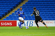 Millwall's Bartosz Bialkowski (33) beats Cardiff City's Leandro Bacuna (7) to the ball during the EFL Sky Bet Championship match between Cardiff City and Millwall at the Cardiff City Stadium, Cardiff, Wales on 30 January 2021.