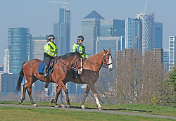 ©Licensed to London News Pictures 26/03/2020<br /> Greenwich, UK. Mounted police on patrol in Greenwich Park, London this afternoon as people make the most of their permitted one a day exercise out of the house from Coronavirus Lockdown. The Prime Minister Boris Johnson has asked people to stay at home to help in the fight against Covid-19. Photo credit:Grant Falvey/LNP