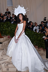 Winnie Harlow walking the red carpet at The Metropolitan Museum of Art Costume Institute Benefit celebrating the opening of Heavenly Bodies : Fashion and the Catholic Imagination held at The Metropolitan Museum of Art  in New York, NY, on May 7, 2018. (Photo by Anthony Behar/Sipa USA)