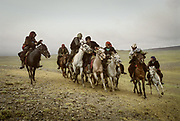 """Buzkachi (traditional afghan horse game) played in Utsch Delgha (""""three valleys"""") previous to a Kyrgyz wedding ceremony. Due to the high altitude, horses can not be bred in the Little Pamir. They are brought from the lower elevations especially Badakhshan region and the Wakhan corridor.<br /> <br /> Adventure through the Afghan Pamir mountains, among the Afghan Kyrgyz and into Pakistan's Karakoram mountains. July/August 2005. Afghanistan / Pakistan."""
