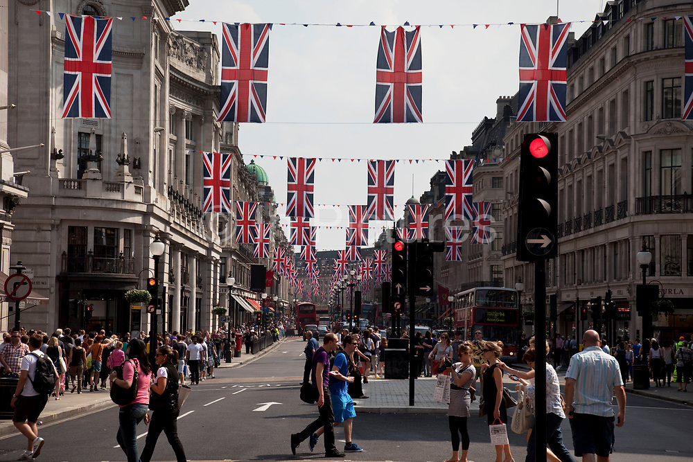 Royal Wedding Union flags on Regent Street, London. A display of 200 giant Union Jack Flags run all the way along from Piccadilly Circus to beyond Oxford Circus. Each flag is 4 x 2.5 metres in size and hang from 22 crossings to celebrate the Royal Wedding, recreating a majestic architectural view of one of the world's most famous historical shopping thoroughfares.