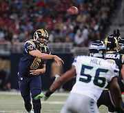 Football - NFL- Seattle Seahawks at St. Louis Rams.St. Louis Rams quarterback Sam Bradford (8) makes a pass over the line of scrimmage in the second quarter at the Edward Jones Dome in St. Louis.  The Rams defeated the Seahawks, 19-13.