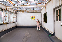 K (73) plays with a ball at indoor exercise area for isolated inmates at the Iwakuni Prison for women in Iwakuni, Yamaguchi prefecture, Japan. <br /> She is serving time for stealing a bottle of coca cola and juice at a supermarket. She is serving her third sentence in prison.