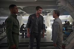 DF-03455rv3 - Fighter pilots Dylan Hiller (Jessie Usher, left) and Jake Morrison (Liam Hemsworth) have contrasting reactions to orders from a superior. Photo Credit: Claudette Barius.