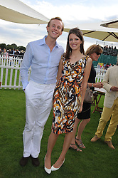 JAMES & GENEVIEVE OSBORNE at the 27th annual Cartier International Polo Day featuring the 100th Coronation Cup between England and Brazil held at Guards Polo Club, Windsor Great Park, Berkshire on 24th July 2011.