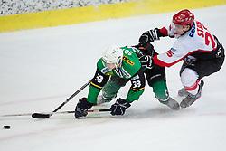Jure Sotlar of Olimpija vs Jure Stan of Jesenice during Erste Bank Young Stars League ice hockey match between HD Jesenice Mladi and HK Olimpija, on November 4, 2012 in Ledena dvorana Bled, Bled, Slovenia. (Photo by Matic Klansek Velej / Sportida.com)