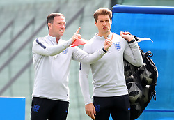 England first team coach Steve Holland (left) and England striker coach Allan Russell during the training session at the Spartak Zelenogorsk Stadium, Repino.