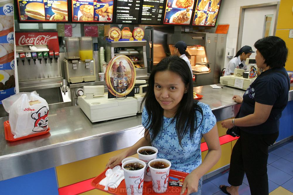 Fast food in Manila runs the gamut from American fast food stores to take-away chains such as Kiss, King of Balls, to the home grown varieties such as Jollibee, pictured here. (Supporting image from the project Hungry Planet: What the World Eats.)