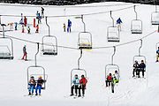 SHOT 2/9/13 3:25:31 PM - Kids and adults ride the Gopher Hill chair lift at Vail's Golden Peak at Vail Ski Resort in Vail, Co. Vail Mountain, at 5,289 acres, is the largest single mountain ski resort in the United States. (Photo by Marc Piscotty / © 2013)