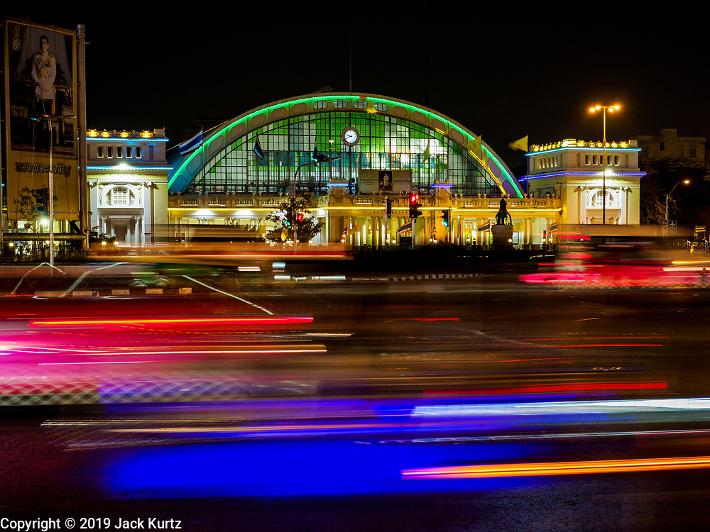27 FEBRUARY 2019 - BANGKOK, THAILAND: Traffic goes past Hua Lamphong, Bangkok's main train station. The station is supposed to close in 2021, when the main train station will move to Bang Sue, in the suburbs about 12 miles from downtown Bangkok. Bangkok, a city of about 14 million, is famous for its raucous nightlife. But Bangkok's real nightlife is seen in its markets and street stalls, many of which are open through the night.        PHOTO BY JACK KURTZ