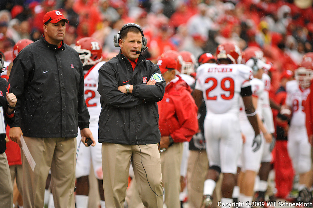 Sep 26, 2009; College Park, MD, USA; Rutgers head coach Greg Schiano (right) looks on with strength coach Jay Butler in Rutgers' 34-13 victory over Maryland in NCAA college football at Byrd Stadium.