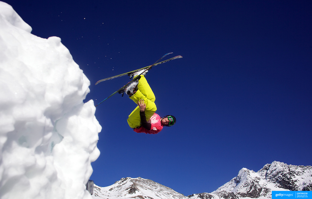Skier Sam Massey, 18, from Queenstown, New Zealand, takes to the air at The Remarkables Ski Fields, Queenstown, New Zealand during a session with 'The Air Bag'  a large inflatable airbag which breaks the fall of the participant on landing and allows valuable experience and a training aid for Aerial skiers and snowboarders. Queenstown, South Island, New Zealand, 18th July 2011