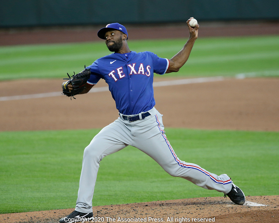Texas Rangers relief pitcher Taylor Hearn works against the Seattle Mariners during a baseball game, Saturday, Aug. 22, 2020, in Seattle. (AP Photo/John Froschauer)
