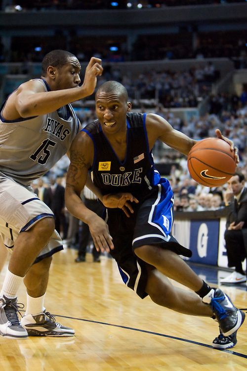 WASHINGTON - JANUARY 30: Nolan Smith #2 of the Duke Blue Devils drives to the basket against Austin Freeman #15 of the Georgetown Hoyas during a college basketball game on January 30, 2010 at the Verizon Center in Washington DC.