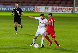 WREXHAM, WALES - Thursday, September 17, 2020: FC Dinamo Tbilisi's captain Giorgi Papava (L) and Connah's Quay Nomads' Aron Williams during the UEFA Europa League Second Qualifying Round match between Connah's Quay Nomads FC and FC Dinamo Tbilisi at the Racecourse Ground. Dinamo Tiblisi won 1-0. (Pic by David Rawcliffe/Propaganda)