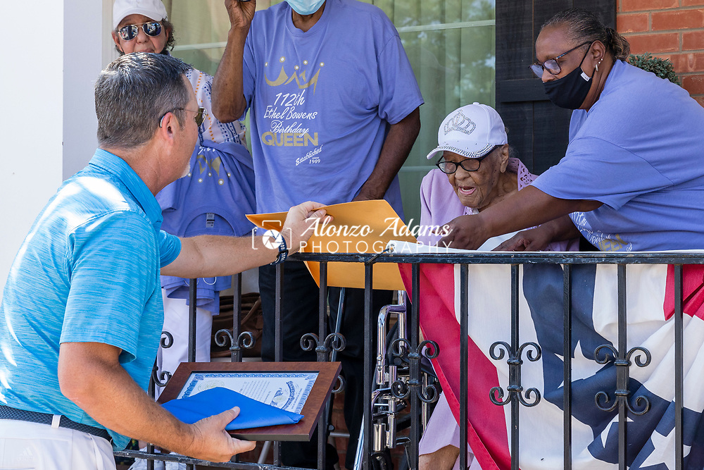 Oklahoma State Senator Chuck Hall, left, of district 20 presents Ethel M. Bowens, center, with a citation and gifts during a celebration parade in Guthrie, Okla. outside of the Golden Age Nursing Home in honor of her 112th birthday and being named the oldest living Oklahoman on Saturday, Aug. 21, 2021. Photo by Alonzo J. Adams.