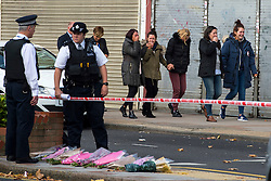 © Licensed to London News Pictures. 11/10/2015. London, UK. Family and friends of the victim being taken to visit the boys at the the scene outside the RE bar in Field End Road, Eastcote, Hillingdon where a man was stabbed to death early this morning (SUN). The victim is believed to be  21-year-old Josh Hanson from Kingsbury.  Photo credit: Ben Cawthra/LNP
