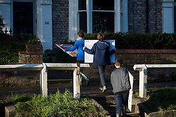 © Licensed to London News Pictures. 29/12/2015. York, UK. A group of young boys return home carry pictures following heavy flooding in the area. Further rainfall is expected over coming days as Storm Frank approaches the east coast of the country. Photo credit: Ben Cawthra/LNP
