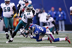 11 Jan 2009: Philadelphia Eagles wide receiver Jason Avant #81 runs the ball with New York Giants cornerback Corey Webster #23 defending during the game against the New York Giants on January 11th, 2009.  The  Eagles won 23-11 at Giants Stadium in East Rutherford, New Jersey. (Photo by Brian Garfinkel)