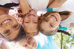 Directly below shot of five girls playing in huddle, Bavaria, Germany