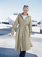 I photographed Jane walking away from her private plane, after she has been traveling; this image was produced for a South Florida garment catalog.
