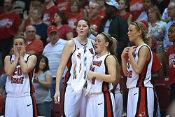 1 April 2010: Katie Broadway, Nicole Lewis, Amanda Clifton and Maggie Krick console each other as the final moments of the game, season, tournament, and for some the college career tick to a close. The Redbirds of Illinois State are dropped by the Golden Bears of California 61-45 in the semi-final round of the 2010 Women's National Invitational Tournament (WNIT) on Doug Collins Court inside Redbird Arena at Normal Illinois.