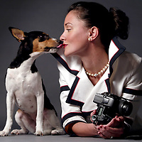 Fashion photographer Dina Scoppettone in the studio of her Sunset Beach, California home with her constant companion Pistola.<br /> Photo by Shmuel Thaler <br /> shmuel_thaler@yahoo.com www.shmuelthaler.com