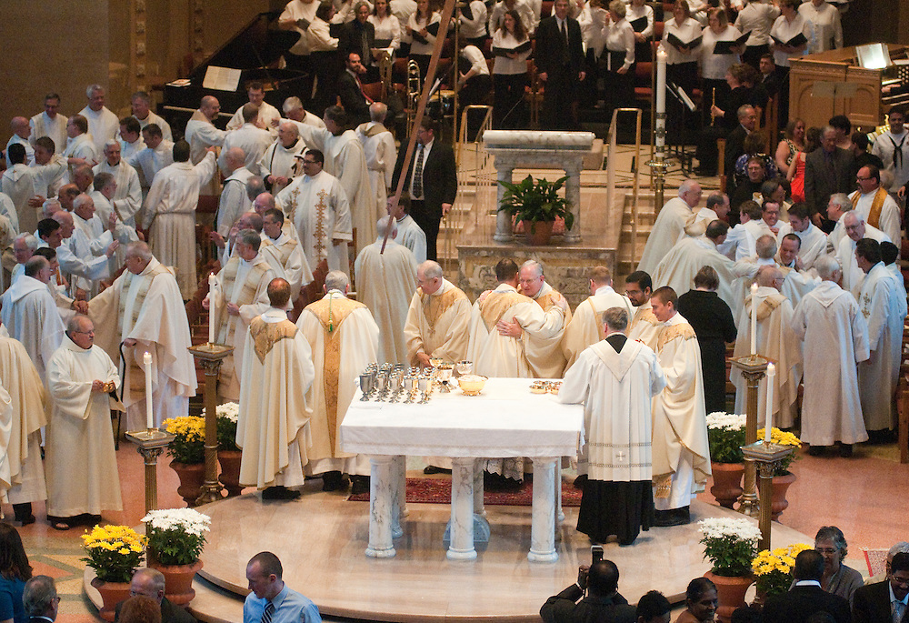 Priests take part in the fraternal welcome.