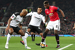 5 January 2018 - FA Cup (3rd Round) Football - Manchester United v Derby County - Andre Wisdom of Derby and Tom Huddlestone of Derby surround Paul Pogba of Man Utd - Photo: Charlotte Wilson / Offside