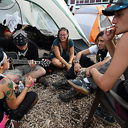 Protesters sing campfire songs at the Romneyville campsite during the Republican National Convention in Tampa, Fla. on Wednesday, August 29, 2012. (AP Photo/Alex Menendez)