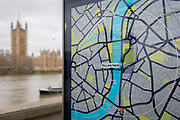 A tourism map showing the River Thames in the centre running between Southwark and Lambeth on the right and Westminster on the left bank, with the Houses of Parliament across the water, on 27th March 2019, in London, England.