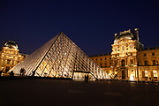 The Louvre Museum, Paris, France concourse lit up at night
