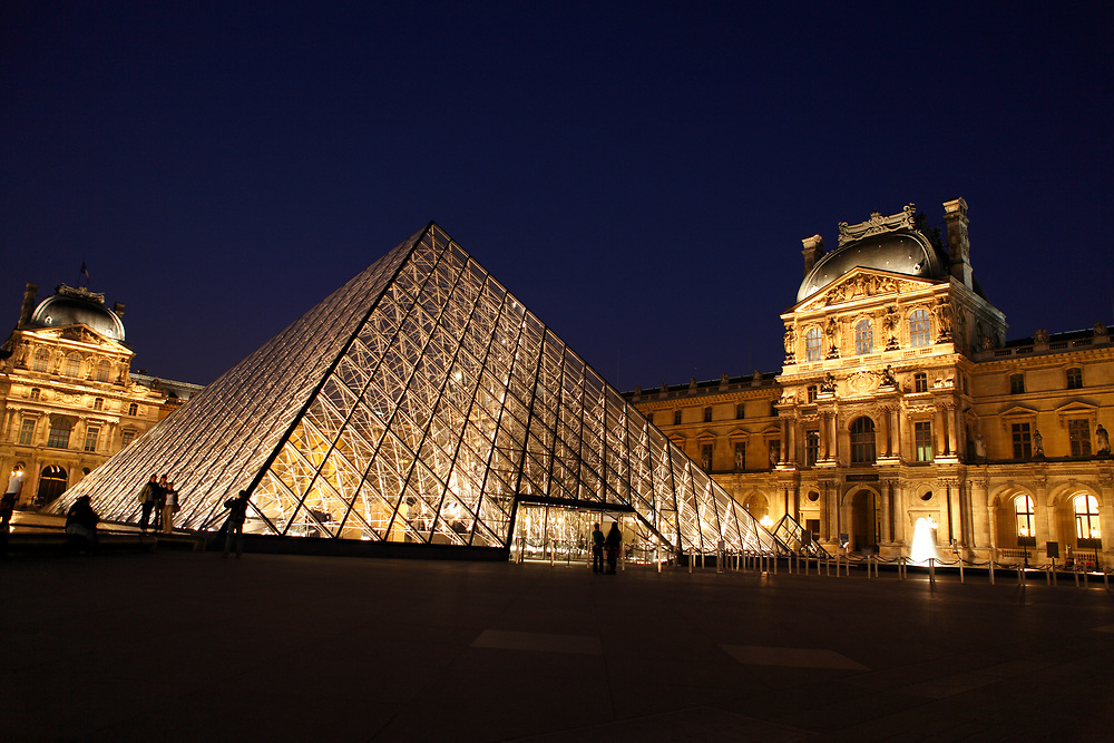 The Louvre Museum, Paris, France concourse lit up at night