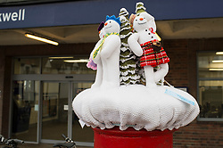 © Licensed to London News Pictures. 11/12/2014. Essex, UK. Forget the impending Weather Bomb about to hit the Seath East, here is the YarnBomb. Chalkwell and Leigh on Sea Railway stations have had their post boxes adornerd with festive knitted sculptures. The artwork has been knitted by The Craft Club Yarnbombers for some festive cheer. Photo credit : Simon Ford/LNP
