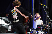 Queens, NY - October 2, 2016. Danny Miller, with his back to the audience, and Max Harwood (drums) of the band Lewis del Mar playing their set at The Meadows festival at Citi Field.