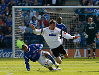 Photo: Steve Bond.<br />Leicester City v Derby County. Coca Cola Championship. 06/04/2007. Darren Currie (R) is brought down by Levi Porter (L)